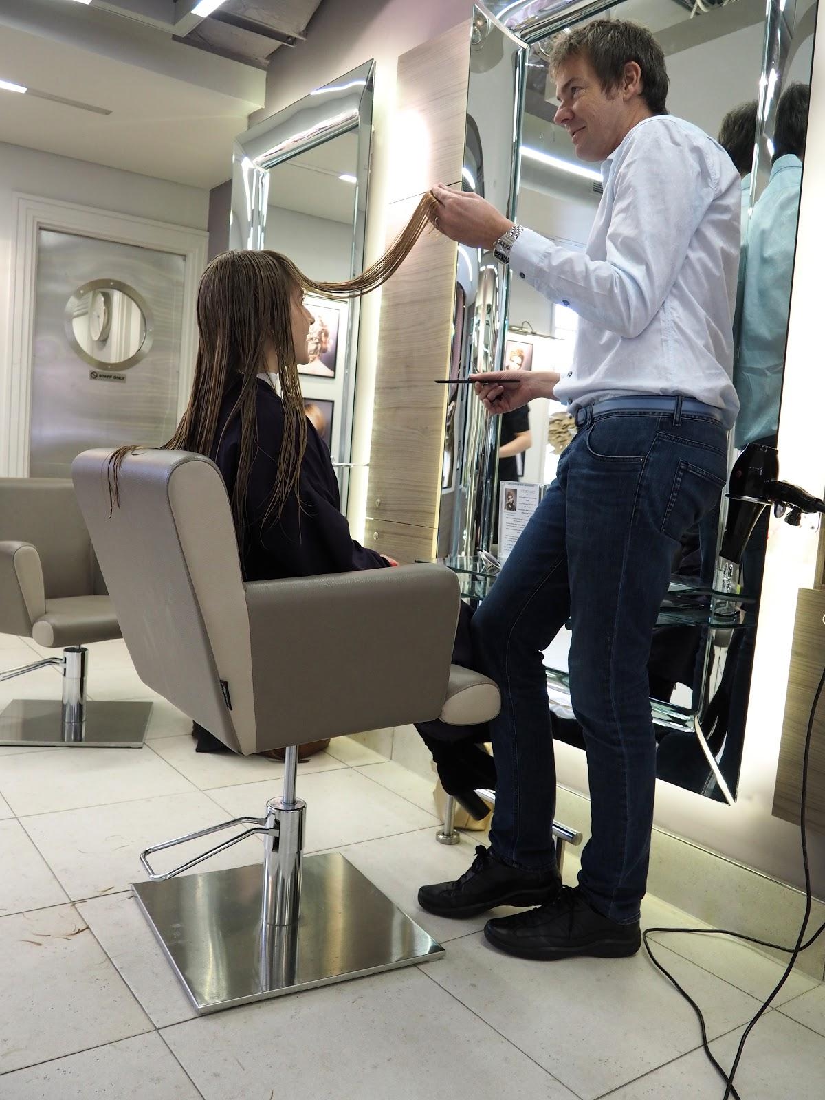 Richard Ward cutting blonde girls hair (Katie Matthews) at the Richard Ward Salon in Chelsea, London