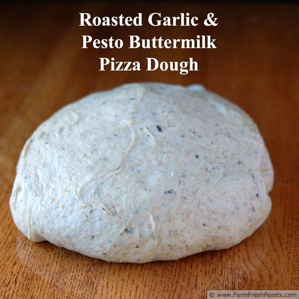 roasted garlic and pesto pizza dough ball