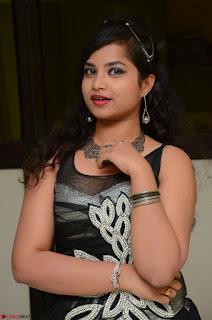 Shrisha Dasari in Sleeveless Short Black Dress At Follow Follow U Audio Launch 071.JPG