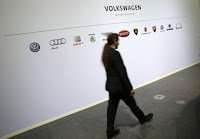 A man walks past the brands of the Volkswagen group during the annual news conference in Wolfsburg, Germany, April 28, 2016. (Credit: Reuters/Fabrizio Bensch) Click to Enlarge.