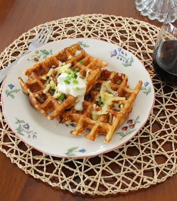 Food Lust People Love: Loaded Baked Potato Waffles with potatoes, cheddar, green onion, sour cream and, of course, bacon!