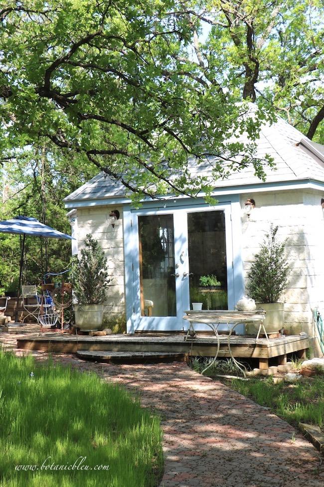 Spring Botanic Bleu limestone garden house in backyard