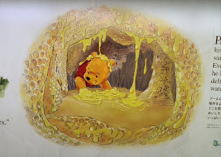 Winnie the Pooh saw delightfull mouth-watcring honey.