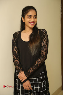 Actress Punarnavi Bhupalam Stills in Black Dress at Pittagoda Press Meet  0017.JPG