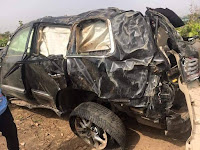crash that killed Minister James Ocholi, wife, son