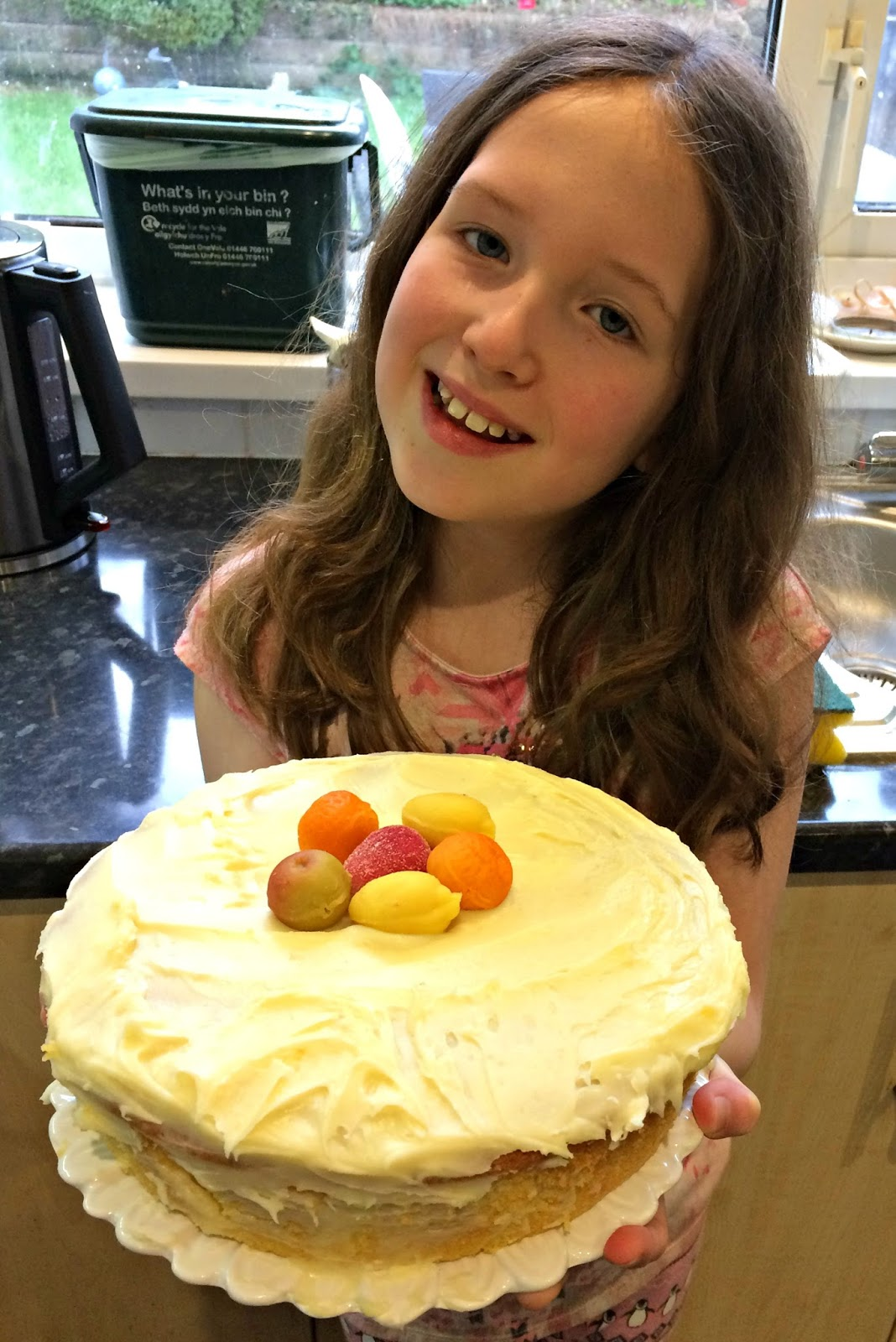 Caitlin holding the finished cake