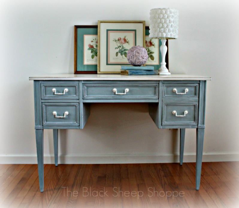Vintage 4-drawer writing desk.