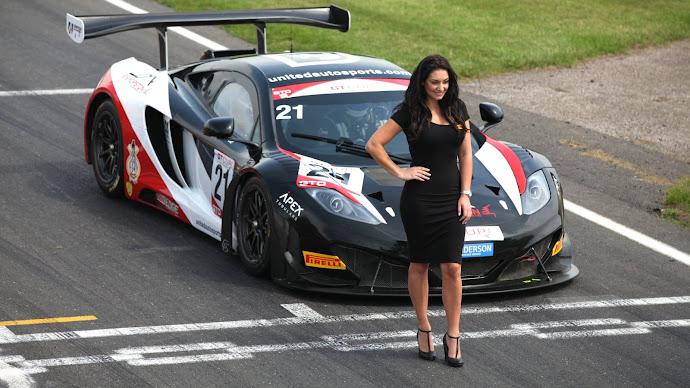 Wallpaper: Beautiful Girl in front of Audi Race Car