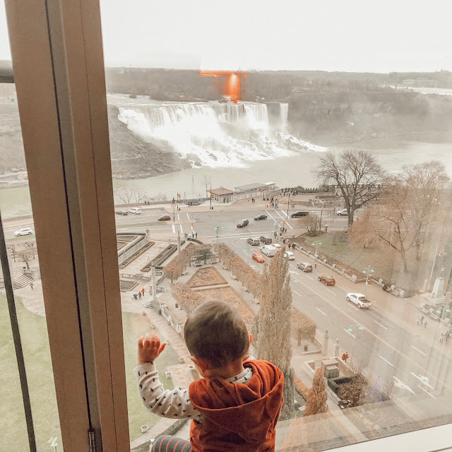 boy looking out the at the niagara falls at the sheraton hotel