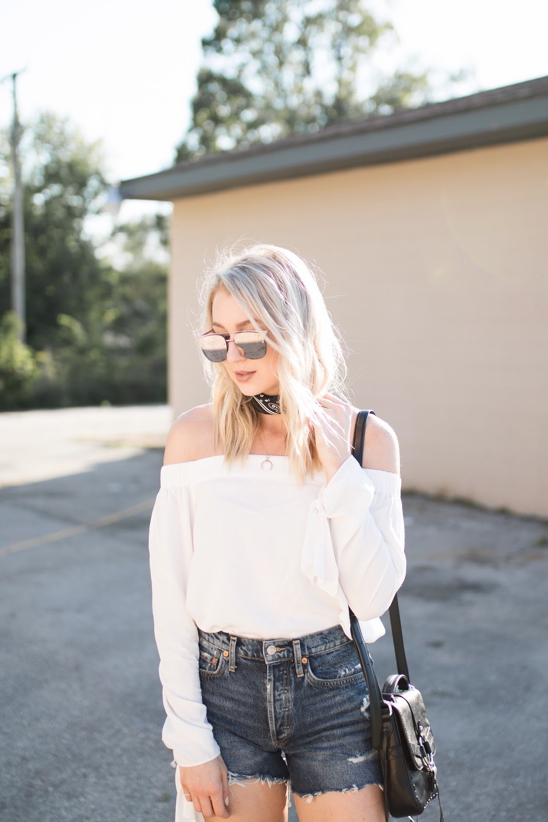 quay sunglasses, bandana scarf, white off-the-shoulder top, cutoff shorts