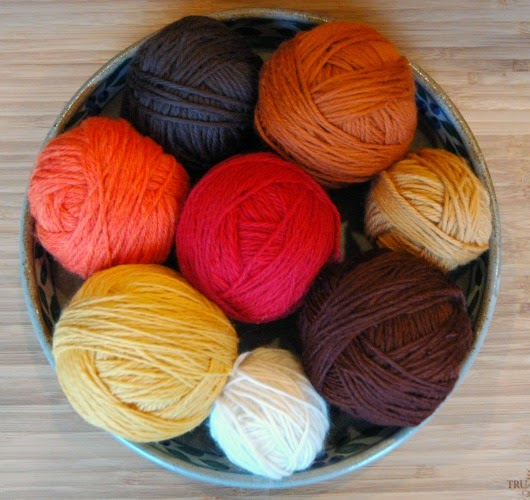 Bowl of fall colored yarn