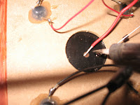 Solder a red wire to the positive terminal of the solar cell