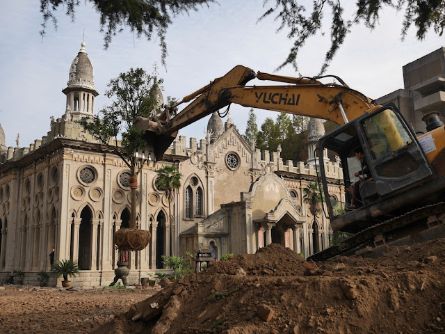 excavator moving a tree at Gudesi Temple