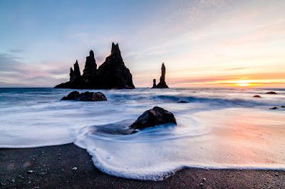 Reynisfjara black sand beach is a must-do on your Iceland road trip