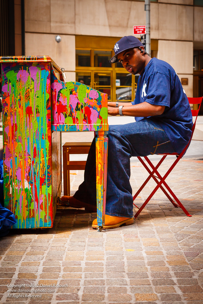 a photo of a piano painted in bright colors in new york city
