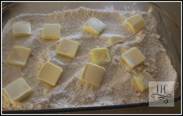 slice up one stick of butter and place evenly over the cake mix.