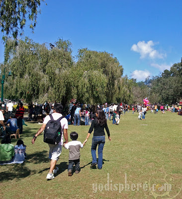 Family walking at Burnham Park Baguio City