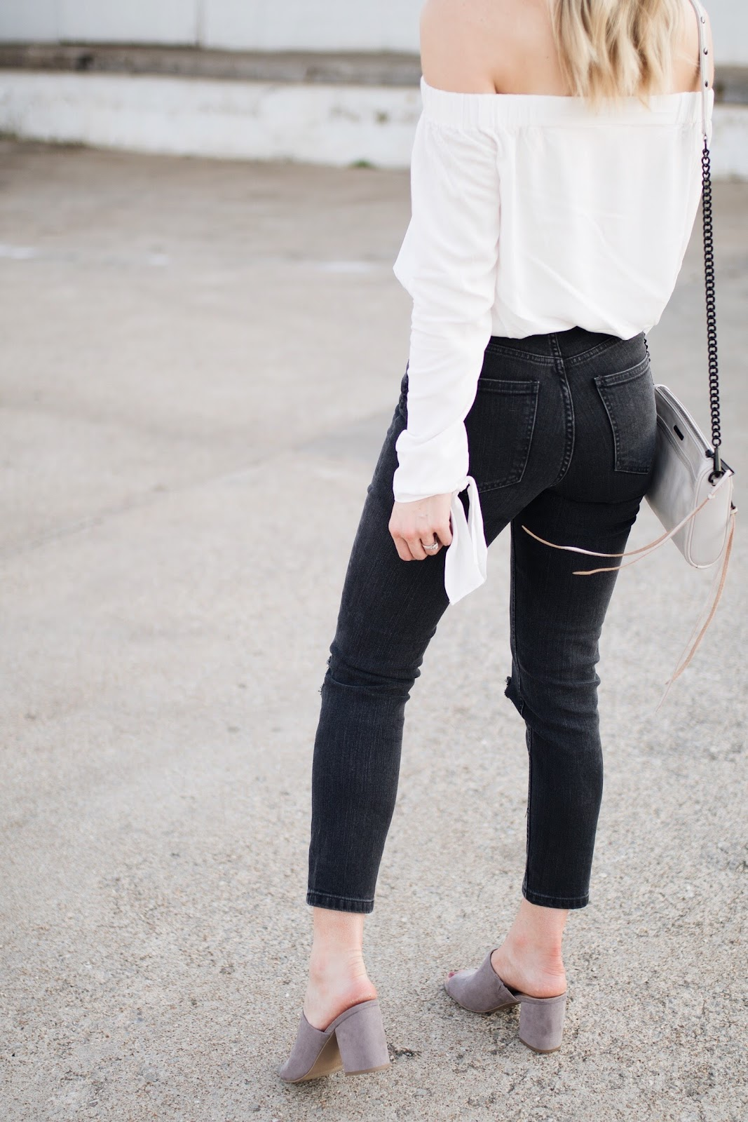 black mom jeans, gray heeled mules
