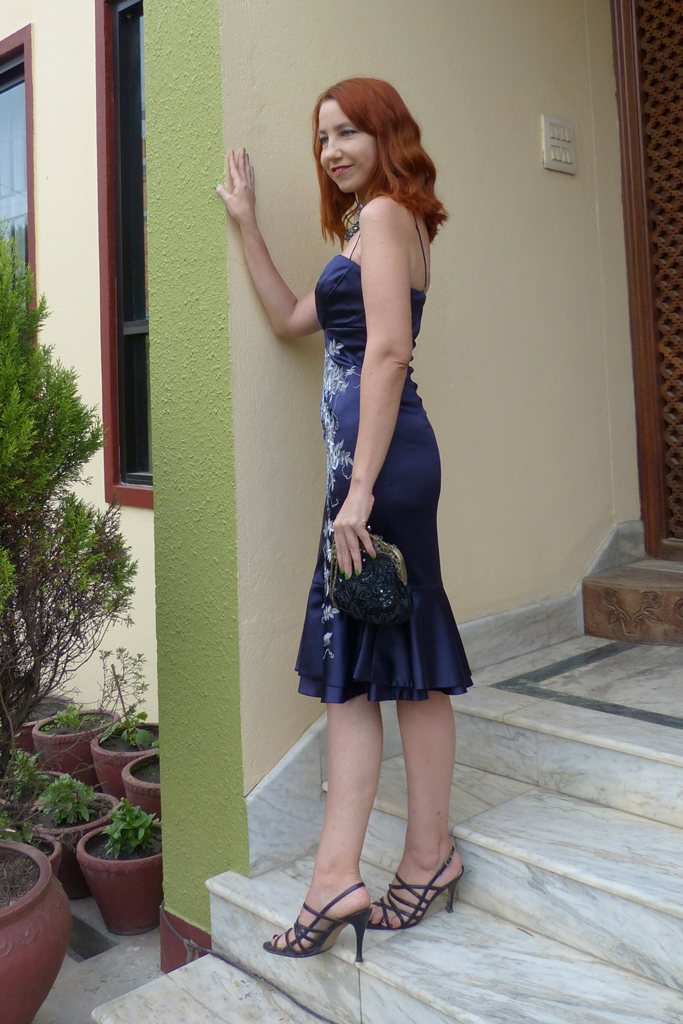 Formal satin dress worn with strappy stilettos