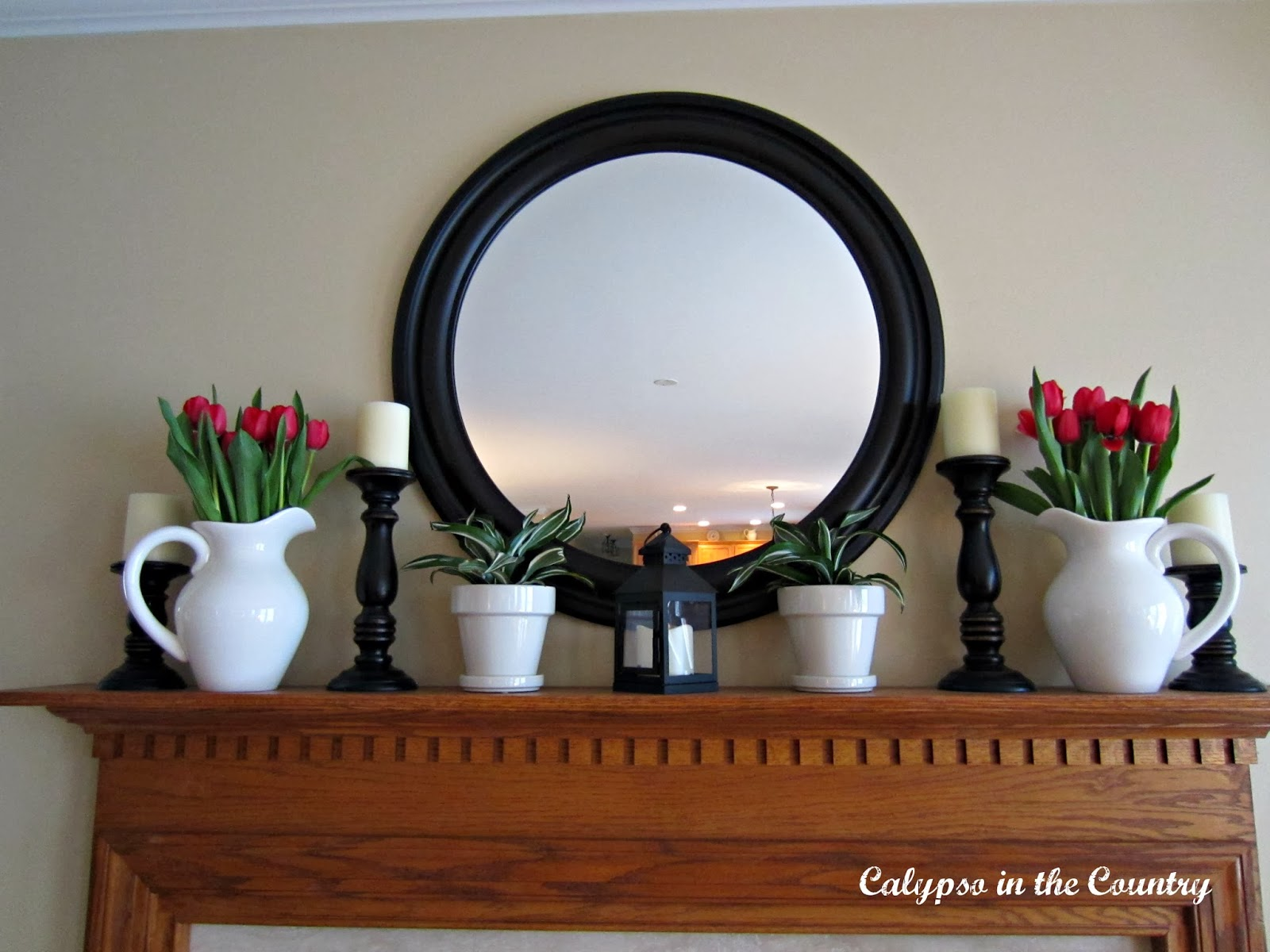 Simple Spring Mantel using tulips, black and white and a Round Mirror