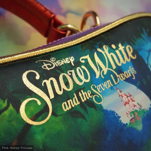 gold lettering on back of handbag saying Disney Snow White and the Seven Dwarfs