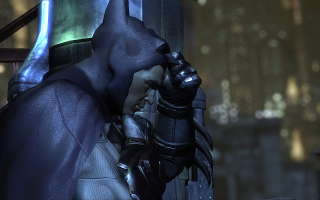 Batman Arkham City putting on suit cowl mask.