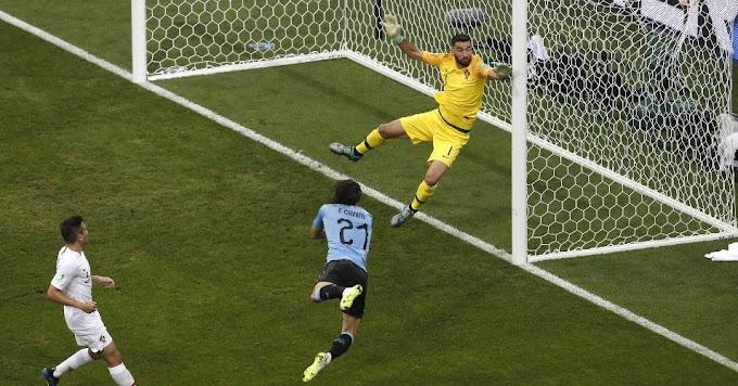 Cavani e Suárez conduzem Uruguai às quartas. Cristiano Ronaldo faz pouco