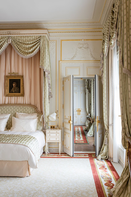 Pink canopy bed and pastels in guest suite at Ritz Paris