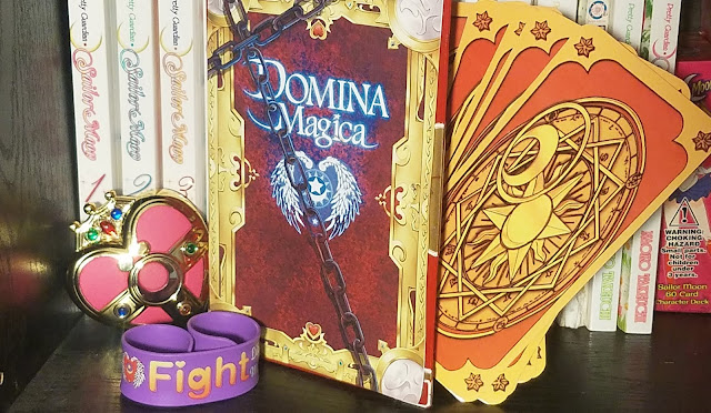 The book and associated goodies including a wristband in purple and yellow.