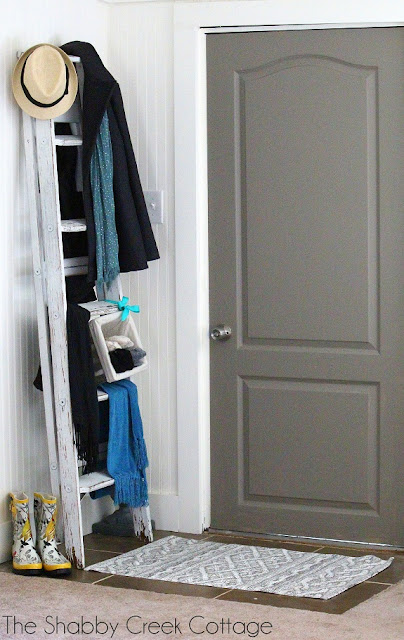 create an entry by using entryway furniture like this old ladder to create an entryway