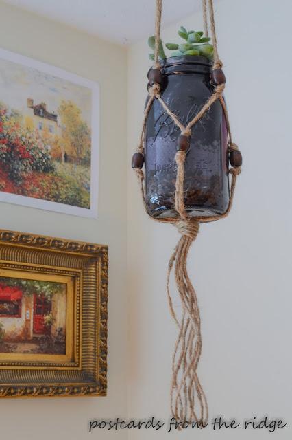 purple mason jar with succulent in macrame plant holder