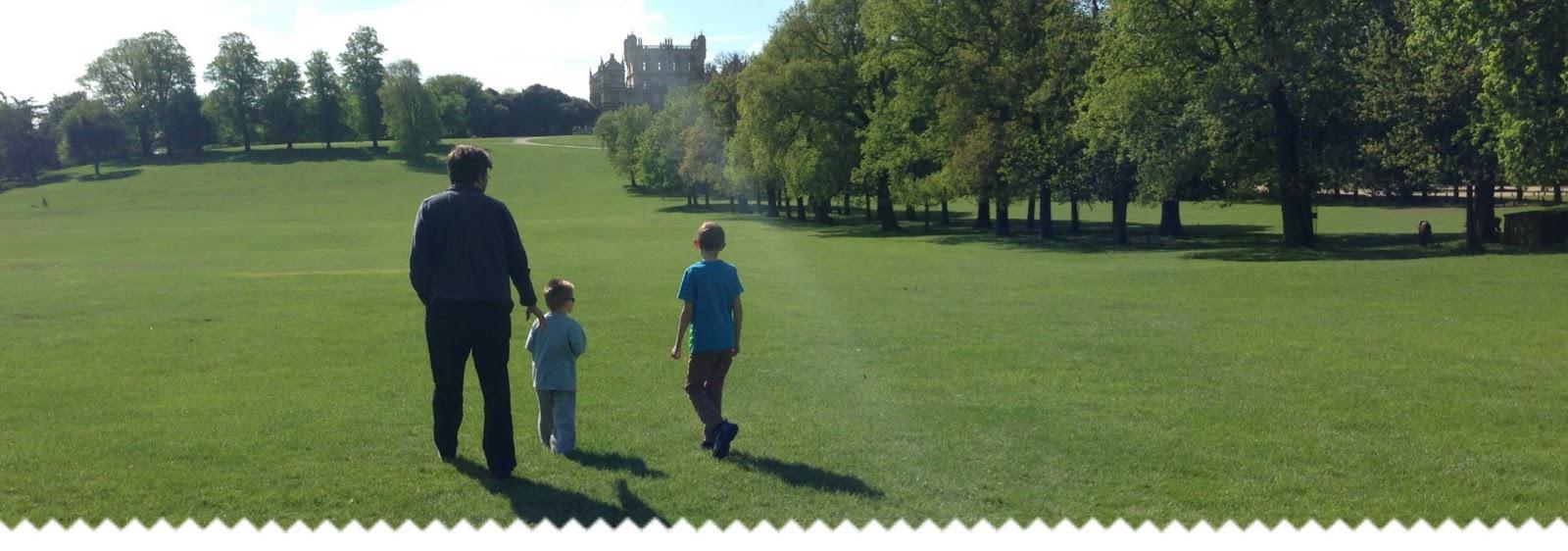 A dad and his boys walking at Wollaton Park