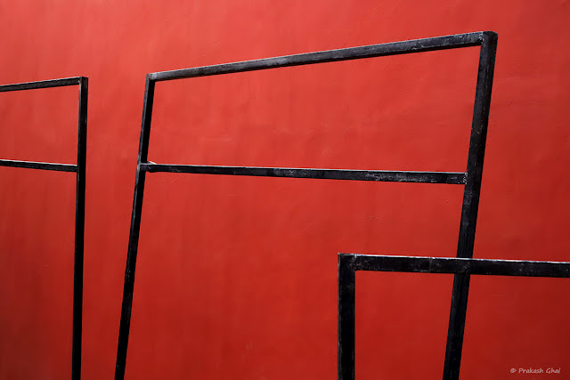 A Minimal Art Picture of Empty Black Frames against the Red Walls at Jawahar Kala Kendra Jaipur