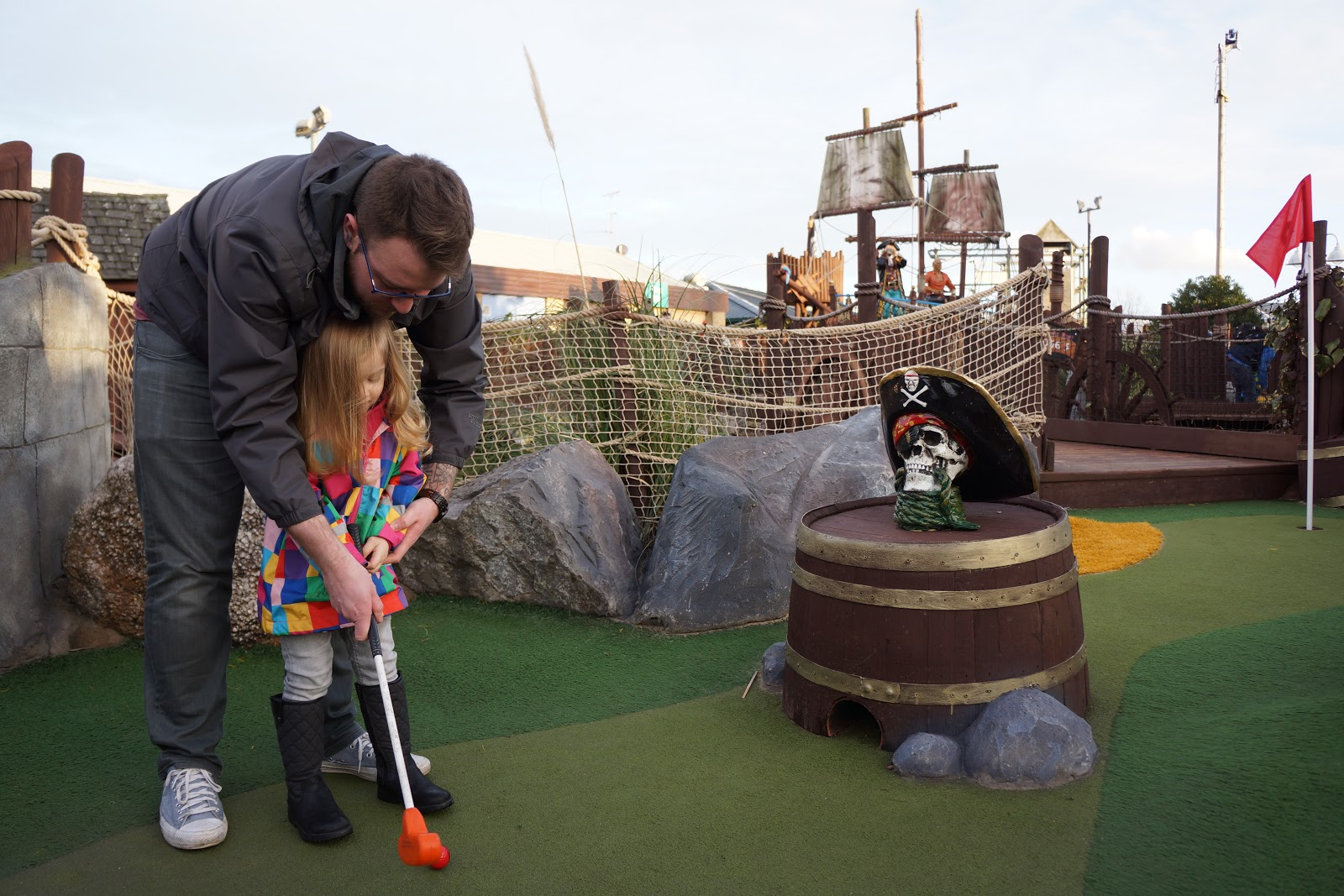 dad and daughter playing minigolf at butlins minehead