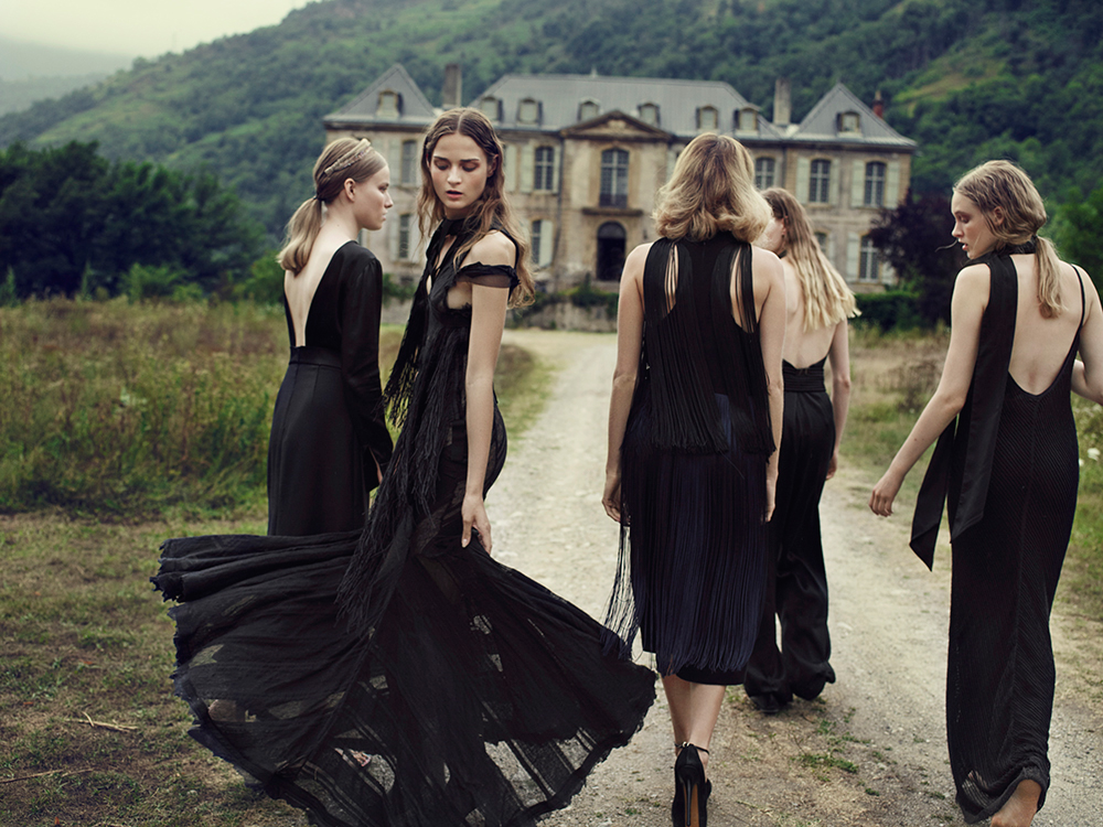 Models in black outside French Chateau Gudanes Brahman's Home
