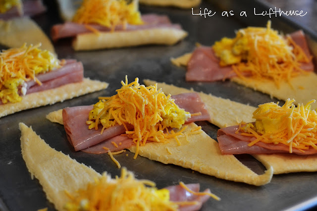 Soft and crispy crescent rolls filled with ham, egg and cheese. Life-in-the-Lofthouse.com