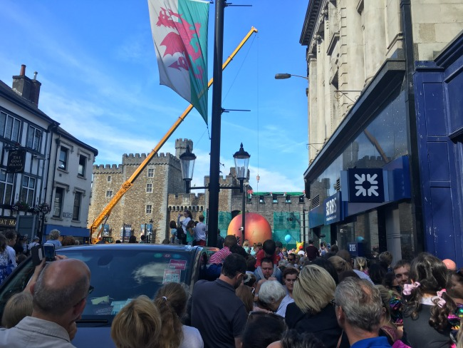 City-Of-The-Unexpected-Cardiff-Celebrates-Roald-Dahl-crowds-crushed-together-giant-peach-in-front-of-castle