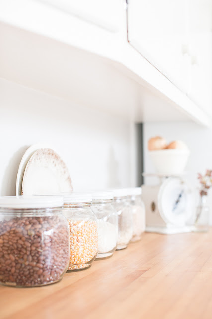 Use beautiful & useful items in you home... like simple, glass jar for dry goods.