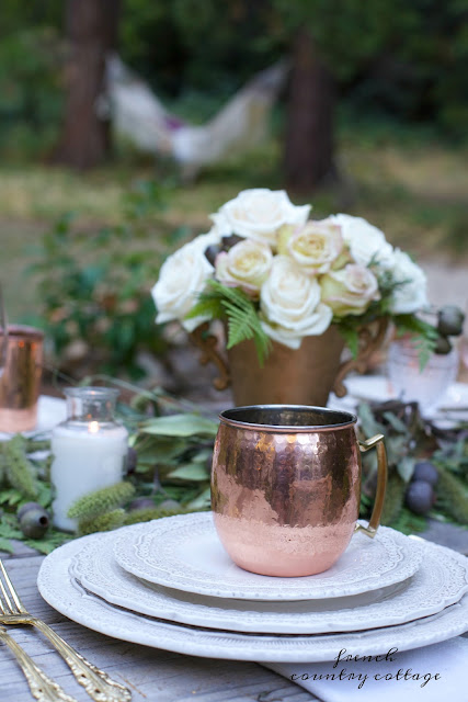 table setting with copper outdoors