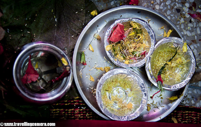 Janeu Ceremony ( Yagyopavitam ) :-Among Hindus a Sacred Thread is a thin consecrated cord, composed of distinct cotton strands, worn to symbolize coming of age.The sacred thread is known by many names ), such as Janeu, Lagun, Yajnopavita, Yagyopavit, Yonya and Zunnar. In Himachal, its called as Janeu and I first time saw this ceremony in a Kangra Marriage. I have attended many marriages in Hamirpur and never saw this.After presenting janeu and rice, it was time to touch his feet with some flowers, kumkum, water etc...All material used during this process except janeu, which is taken care by priest only !!!Priest arranging janeus for next set of relatives...Almost every relative of same gotra needs to be present for this ceremony.Water with mix of Gangajal, Colored rice, flowers, dhruva and something sweet in a plate !!When all ceremonies are done at groom's place, everyone gets ready for barat. All the relatives, friends and people from same village go to Bride's place with relevant stuff.All important people in Barat wear Pagadi and these days most of the folks get something to signify their presence in barat. Even small kids get some colorful strolls or designer caps...As the Barat reaches, Groom and Bride are directly taken to the stage for Varmala. Few years back, it was not considered as the right thing to do. Usually there used to be place where Barat had to stay for some time. Priest from bride's side used to come to Janvasa and do some rituals. After Milni, takes place near Janvasa and Barat goes to Bride's home. Then all ceremonies used to happen in Vedi and no stage :)Vara Satkaarah and Var Mala ceremonThe actual marriage ceremony begins with the ritual of the Vara Satkaarah in which the bridegroom and his friends and relatives are welcomed and received at the entrance of the hall where the wedding is to be conducted. The mother of the bride applies tilak on the groom's forehead and performs aarti to bless him and to ward off any evil. This is followed by 