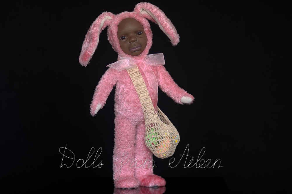 ooak Easter Bunny teddy doll with a bag full of Easter eggs, posing for camera