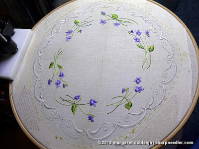 A nearly completed centrepiece with all the violets done and just a bit more edge to embroider. (Society Silk Violets)