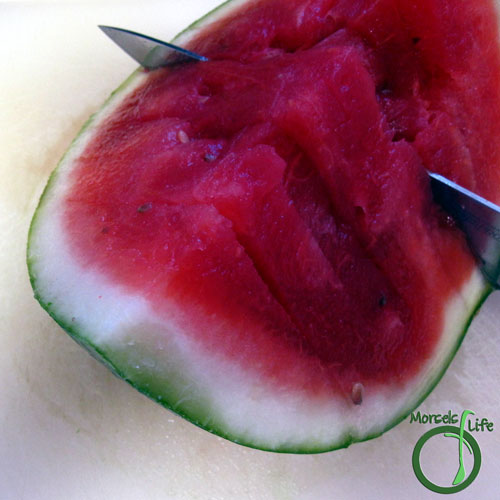 Morsels of Life - How to Cut a Watermelon Step 4 - Flip each watermelon quarter over and slice. Again, if you're smarter than me, you won't make the slices too close together.
