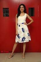 Actress Ritu Varma Stills in White Floral Short Dress at Kesava Movie Success Meet .COM 0162.JPG
