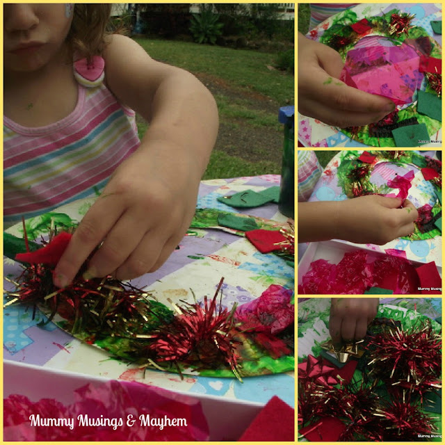 An easy to set up Christmas activity that is perfect for little toddler hands and attention spans! Make Christmas wreaths to hang on the tree or wall!
