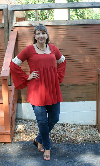 Get ready for fall with this trendy, pumpkin colored, bell sleeved tunic from Pink Blush! It is perfect for jeans or leggings!