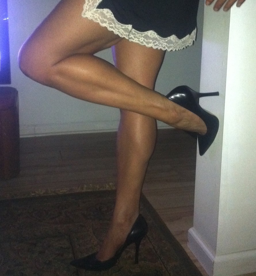 Muscular legs in pantyhose