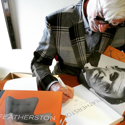 Geoff Isaac signs a copy of the book he wrote on Grant Featherston.