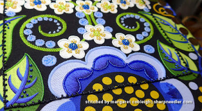 Outlining thread painted petals with beads using a beading koma (Wild Child Japanese Bead Embroidery by Mary Alice Sinton)