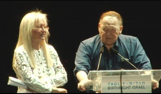 Sheldon Adelson (right), CEO of Las Vegas Sands, speaks with his wife at a charity event in Jerusalem, Israel, late last month.